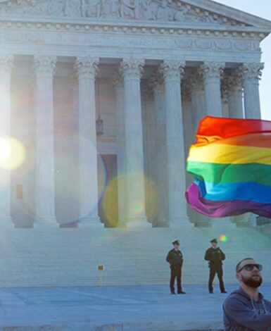 A man waving an LGBTQ flag in front of the Supreme Court
