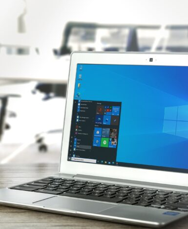 A laptop sitting on a desk, ready for mobile computing
