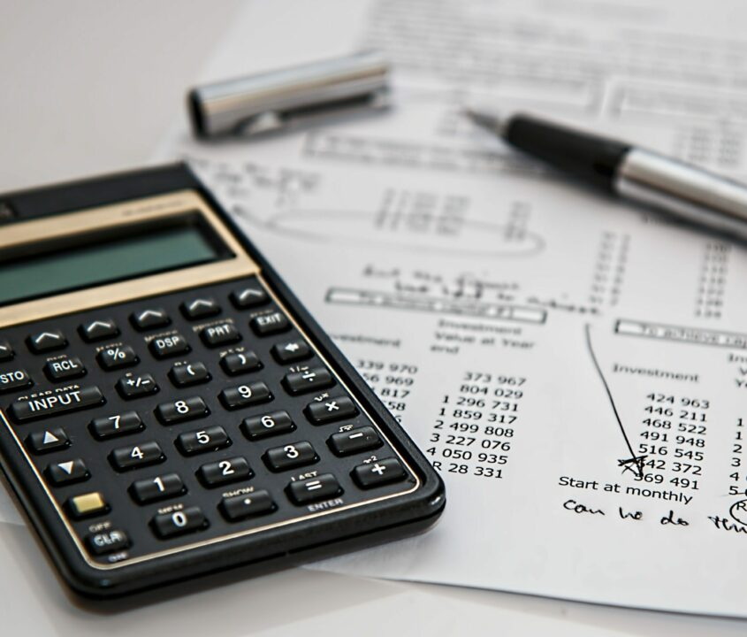 calculator and papers. apply lessons from economics for your daily life