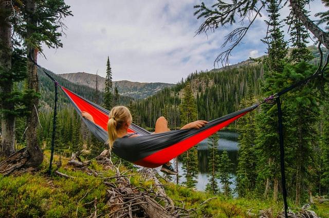 Summer break - woman in hammock in mountains
