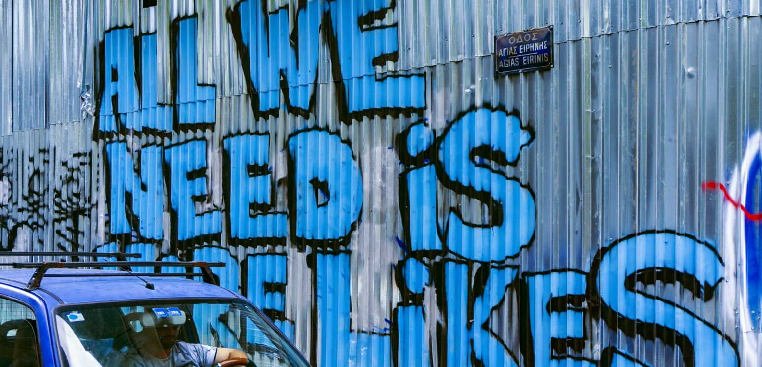Graffiti reads: All we need is more likes. Social media misinformation spreads rapidly.